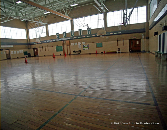 The South Middle School gymnasium floor was refinished by the Brockton Sports Foundation after a leaking pipe ruined a portion of the flooring.